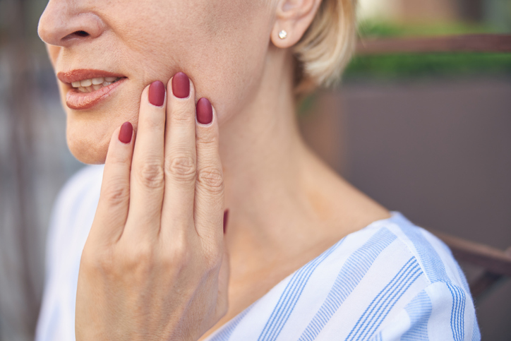 Female Suffering From An Acute Dental Pain